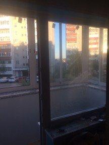 Холодное остекление балкона в кирпичном доме